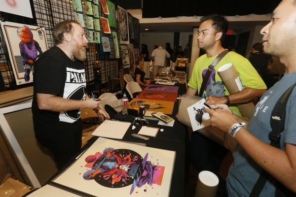 Sonny Day manning the We Buy Your Kids booth at the first MondoCon - Austin, TX 2014